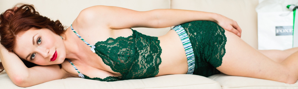 Rebecca Bujko wearing a forest green FOXERS lace set