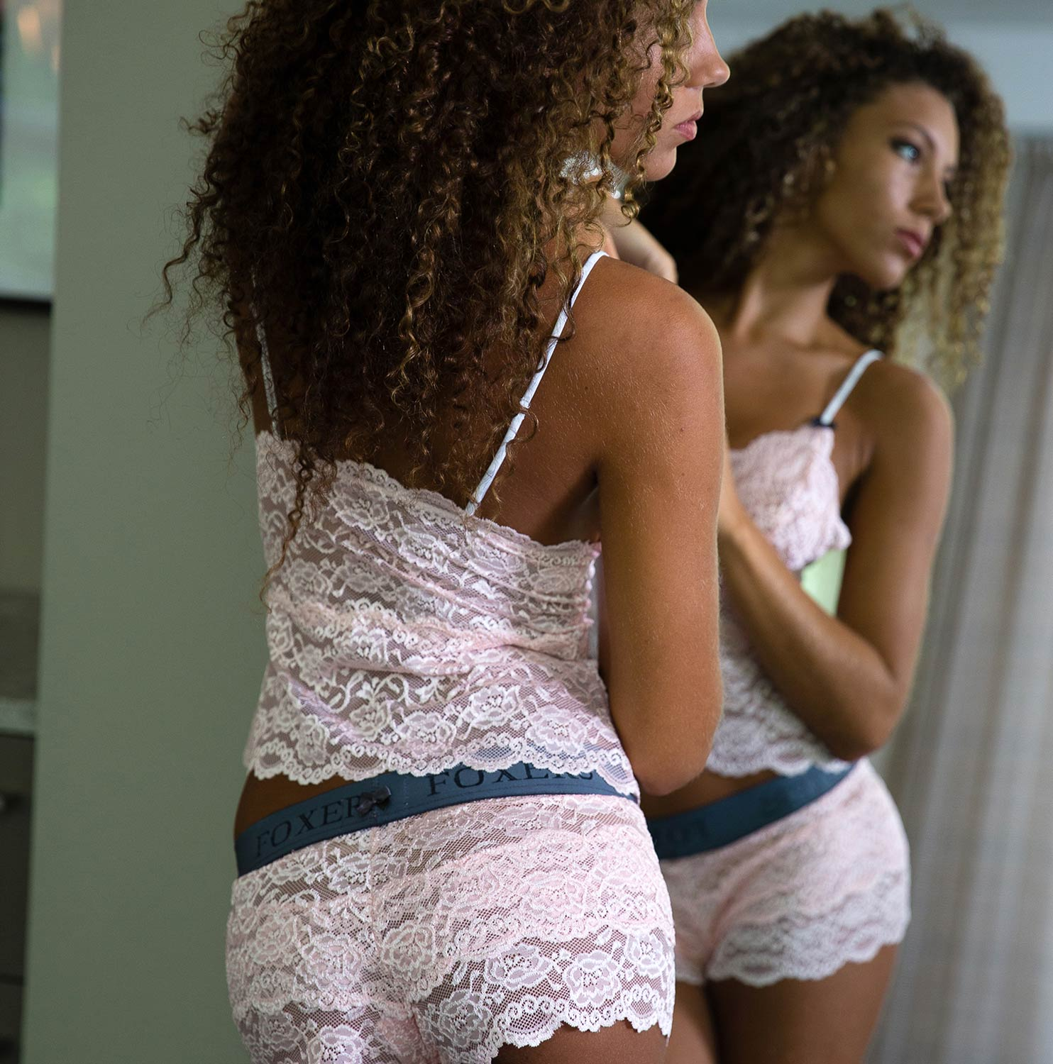 Jordan is wearing our Pink Lace Camisole and Matching Lace Boxers